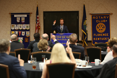 William C. White of the Cincinnati Symphony conducts an interactive address to the Florence Rotary Club.